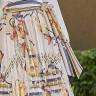 saia leticia rodada de pregas jany pim frente baixo detalhe
